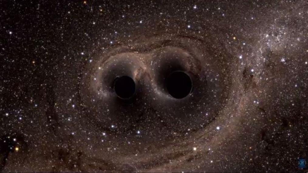 Deux trois noirs qui entrent en collision, générant des ondes gravitationnelles.